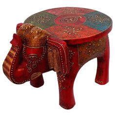 This hand carved Elephant Stool is made of mango wood. Pretty and practical, this piece is made using solid reclaimed wood. The gift piece has been prepared by the master artisans of Jaipur.  Product Usage: This utility item can be used as a show-piece in...