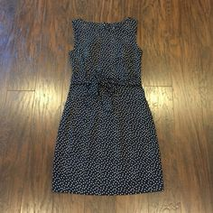 Tommy Hilfiger Polka Dot Dress Dress has been worn a couple of times but it's in absolutely great condition. It has a belt on the waist. Dress falls above knee height. Color is navy with white polka dots. Great as a Christmas dress! Tommy Hilfiger Dresses
