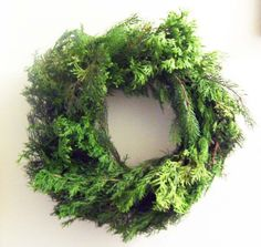 Step by step, illustrated guide on how to make an evergreen Christmas wreath using inexpensive and free materials.  Welcome guests to your home with the natural scent of evergreen.