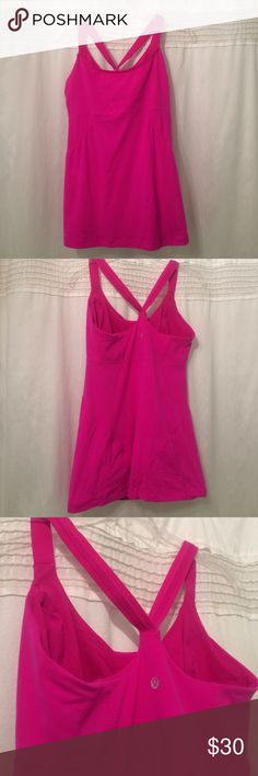 Lululemon tank. Hot pink Lululemon tank with built in adjustable bra.  Gently used.  I believe it's a size 8.  From one underarm to the other is 16 in, across bottom seam 20, top of shoulder strap to bottom 27, waist 16. lululemon athletica Tops Tank Tops