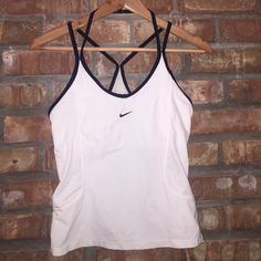 Nike workout top Nike workout top with strappy back. Great condition. Nike Tops Tank Tops