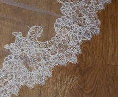 Close up of Cara's  bespoke wedding veil lace