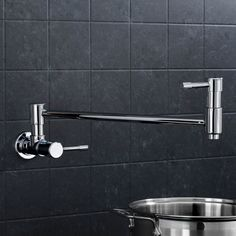 This is a swing spout pot filler faucet designed for cold water use. The spout elongates to 17 inches from the wall. This is mounted on the wall. There are two valves with the lever at the base as well as near the spout