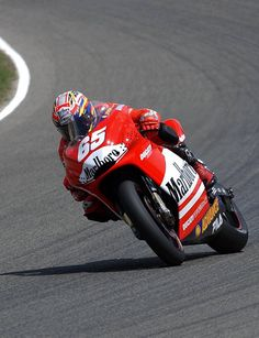 Loris Capirossi slides his Ducati perfectly at high-speed.