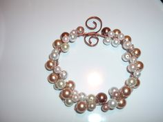 Christmas Wire Weath,I made this with 16 gauge wire and glass pearls. I like the way it turned out.