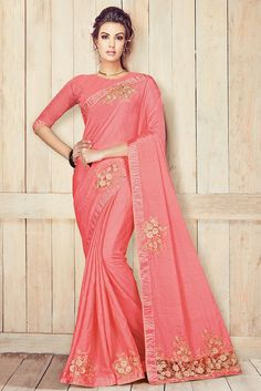 This Super Stylish Party Wear Saree with Satin Fabric This Saree Is Exclusively Crafted With Embroidery,Lace Work,Thread Work. This Peach Colour Saree Comes With Matching Blouse and Can Grace Any Body...