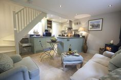Retreat into the beautiful open plan living space, a wonderful room with peaceful Farrow & Ball colours and comfy furnishings. Cottage Living Room Small, Small Cottage Interiors, Small Living Rooms, Living Room Designs, Living Spaces, Cotswold Cottage Interior, Modern Cottage, Living Area, Cottage Open Plan Kitchens