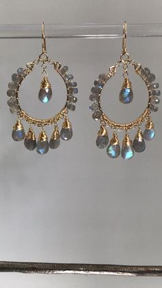 Labradorite Gold Hoop Earrings AAA labradorite blue flash briolettes and rondelles are wire wrapped to dangle on hand formed gold filled chandelier hoop earrings. Geode Jewelry, Jewelry Design Earrings, Gold Hoop Earrings, Bead Earrings, Bridal Earrings, Crystal Earrings, Crystal Jewelry, Diy Chandelier Earrings, Beaded Chandelier