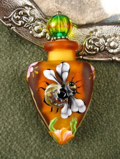 Kerri Fuhr - Amber Honeybee Aromatherapy Vessel.  I LOVE this.  I just wish the stopper weren't green.