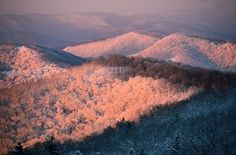 Dawn in the Blue Ridge Mountains of Fairview, North Carolina.  Photo by Amy White & Al Petteway / National Geographic Stock   http://www.nytstore.com/Snow-Covered-Mountains_p_10818.html