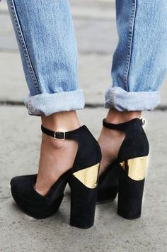 Obsessed with these black and gold heels.