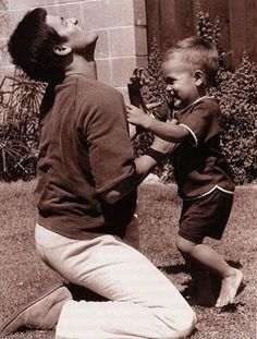 Bruce Lee. Teaching the moves to his son Brandon.
