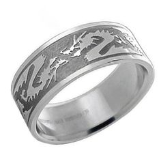 Dragons are known in Asian cultures as symbols of strength and good luck. This stainless steel band makes a terrific gift for anyone interested in Asian culture or someone looking for mens rings that show off an aggressive and striking look. Bling Jewelry, Jewelry Rings, Jewellery, Chinese Zodiac Dragon, Wedding Ring For Him, Dragon Jewelry, Sell Gold, Discount Jewelry, Pearl Pendant