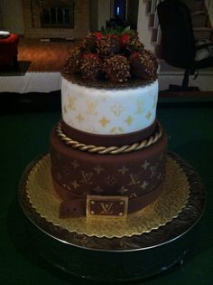 Louis Vuitton cake with chocolate covered strawberries.