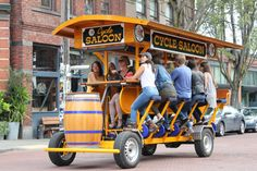 19 Seattle bars & breweries line Leary Wy, in Fremont & Ballard. Pubcrawl in CYCLE PONTOON, or CYCLE SALOON. Latter has 8-10 pedalers, & 16 total riders.