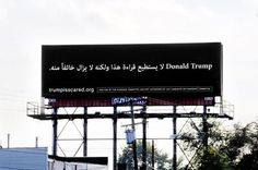 """Arabic message on a Detroit billboard reading, """"""""Donald Trump, he can't read this, but he is afraid of it."""""""