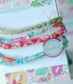Boutique bracelet made by Betsy Veldman (using paper beads and fabric strips)
