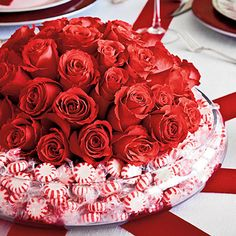 Peppermint Candy Christmas Centerpiece | For the centerpiece, place a low bowl of roses in a larger bowl and fill in between with mints.