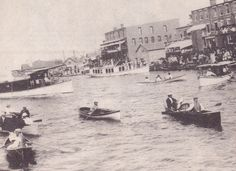 This was the Clayton waterfront at the turn of the century. The Banker block is at right, while the Williams block is at center. Skiffs and launches filled the waterways were, each summer, vintage vessels such as these again pass by here during the annual Antique Boat Show, while thongs of people watch from the shoreline and other boats.
