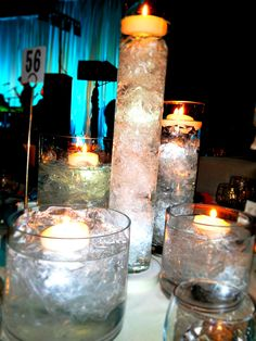 beautiful and inexpensive centerpieces. Use all kinds of vases, fill with bubble wrap or plastic wrap and water; float the candles.  It looks like they are floating on ice!!!