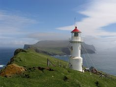 A spectacular setting of a lighthouse in the Faroe Islands of Denmark in the North Sea