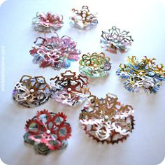 Junkmail Snowflakes - Present toppers!  These are beautiful and have a great tutorial