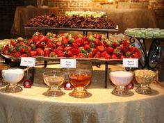 A great and affordable way to wow your wedding guests is to create food stations.  A great idea is a sweets station. This wedding food station has strawberries as its centerpiece.  However, it is also adorned with different chocolates, and these great dipping sauces.  You can serve this delicious fruit as a prelude to any meal, be it buffet,  or sit down dinner.