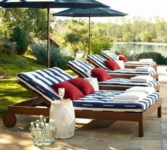 modern pool area furniture wooden chaise lounge chairs white blue stripes cushions