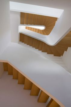 New York firm Space4Architecture has added a curving white staircase with oak treads to a historic townhouse in the city's Upper West Side