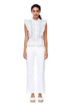 A floral-print cotton blouse with rows of ruffles.