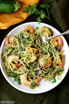 Pesto Zucchini Noodles and Shrimp - Quick and easy dinner recipe with tender zucchini noodles and perfectly sauteed shrimp tossed in a delicious basil pesto sauce. Healthy Noodle Recipes, Zucchini Pasta Recipes, Pesto Zucchini Noodles, Grilled Shrimp Recipes, Zoodle Recipes, Veggie Noodles, Spiralizer Recipes, Sauteed Shrimp, Seafood Recipes