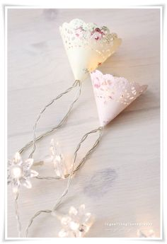 DIY:  How to make these cute shades for string lights!  Great idea for a wedding!!!