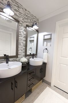 Bathroom redo on a budget - love the glass tile wall and raised sinks
