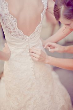 Lace wedding gown with intricate buttoned back  (via Plano Wedding: Image #365247: Style Me Pretty)