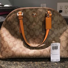 401458267f Coach purse Tan coach purse with orange trim and handles. Also has a  matching wallet