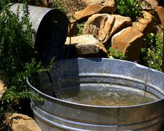 Humble Elements - A bucket pours an endless stream into a trough  (via Farmgirl Bloggers)