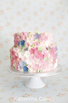 Pretty 2 tier cake from Sussex based Kasserina Cakes, with buttercream and sugarpaste flowers. Perfect for wedding!