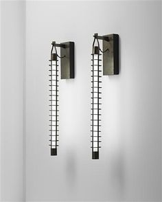 FRANCO ALBINI  Pair of wall lights, designed for the National Institute of Assurance Office Building, Parma, 1950–54.  Patinated brass, patinated tubular brass, stained wood, neon light (2).  Each: 70 x 10 x 16 cm (27 1/2 x 3 7/8 x 6 1/4 in)