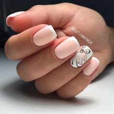 Beautiful nude and white winter nail art design. The design also incorporates thin white french tips with embellishments on top and a thin detail of a butterfly in black polish.