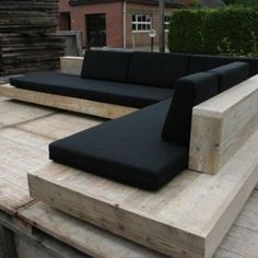 Timber seating with black cushions. A beautiful and timeless combination. Pinned to Garden Design - Outdoor Furniture by Darin Bradbury.