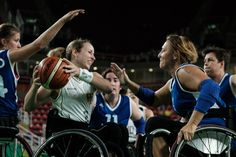 Germany's Annika Zeyen (2nd L) vies for the ball with France's Agnes Etavard-Glemp (R) during the women's wheelchair basketball quarterfinal in the Paralympic Games at Olympic Park in Rio de Janeiro on September 13, 2016. / AFP / YASUYOSHI CHIBA