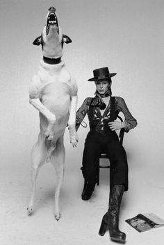 Terry O'Neill - Singer David Bowie posing with a large barking dog while working on the artwork for his 1974 album 'Diamond Dogs' in London.