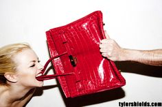a red crocodile Birkin, the most sought after bag in the world. theres a waiting list and some of them can run up to $100,000. by Tyler Shields