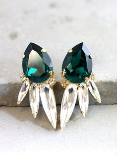 Get a sparkly look with Our Signature Swarovski Crystal Sparky Earrings, faceted for extra shine in a delicious variety of colors finishes and styles  These handmade cushion cut shape Swarovski Earrings 24 k plated over brass are designed to make an impact set with black diamond Crystal and finished with white small clear crystal halo An elegant way to finish day or evening looks sweep your hair to the side to showcase.  Petite Delights is an Official SWAROVSKI® Branding Partner Official…