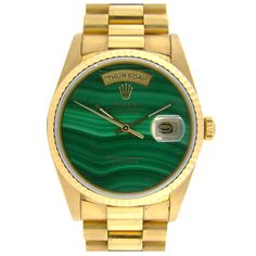 A very collectable Day Date with unique malachite dial. A double quick Day Date movement. 18K yellow gold case in excellent condition.