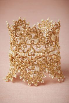 This unique lacey cuff could add a lovely bohemian touch to your lace/ sheath wedding dress. Pair it with a dainty gold crown/ halo or a delicate floral halo.