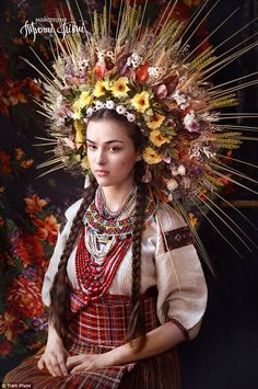 A woman models a traditional Ukrainian vinok- in this case made from flowers, leaves and b...