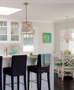 Waterleaf Interiors: Lovely airy beachy coastal kitchen design with soft gray walls, chrome pleated drum ...