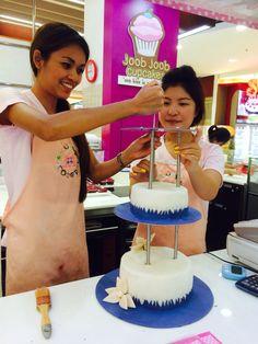 annie at joob joob creating another custom wedding cake