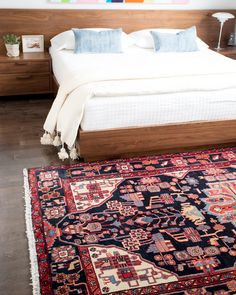 We love bold vintage rugs paired with custom furniture. Especially when it is a bedroom piece like this.